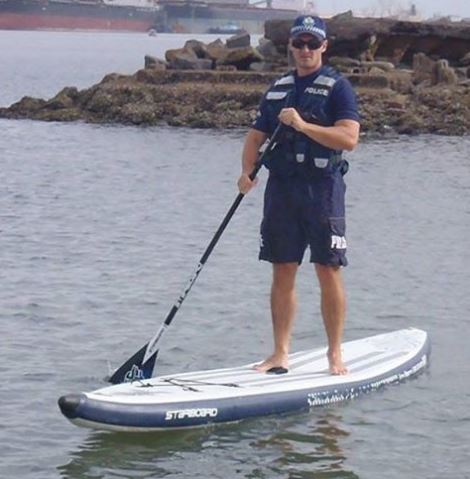 Australia Cop on InFlatable Paddle Board