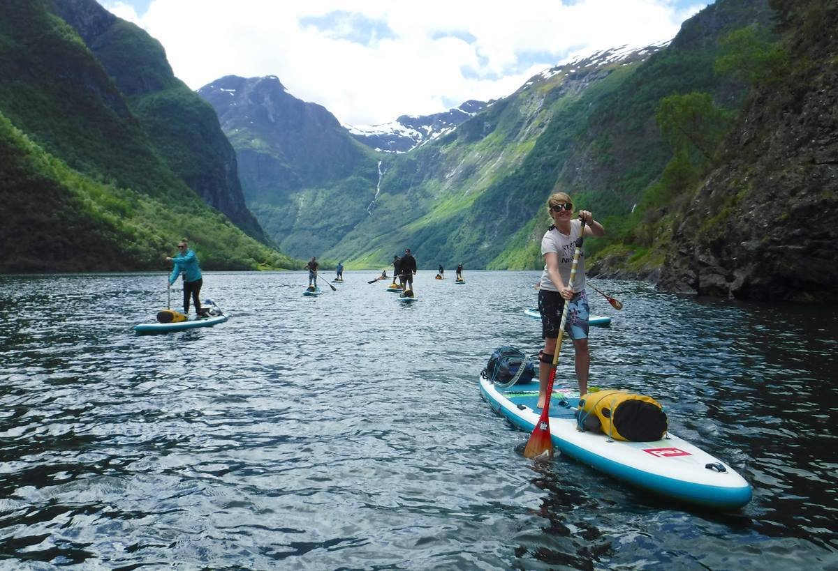 SUP Norway guests paddling through the fjords.